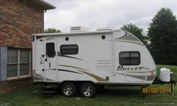 2011 Bullet Ultra Lite Travel Trailer under 20 foot long, 1 slide out, heat/air, 2 burner cookstove, refrigerator, microwave, large kitchen sink, stereo, television, queen bed with bunk bed above, sleeper sofa, bathroom with shower, outside shower, plenty