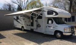 2011 Jayco Greyhawk 31DS Class-A Motorhome. White exterior Crimson interior. 6.8L Triton V10 Engine on a Ford Chassis. 5 speed Automatic with Overdrive & Cruise Control. Gasoline engine with very low 8689km. Can tow up to 5000lb/2268kg Hellwig Helper