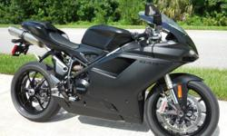 2012 Ducati 848 Evo Corse with 2436 careful miles. This bike was done in the matte black paint with gloss black emblems. This is one stealthy looking bike. You will not find a blemish on this bike anywhere and its a 10 all the way. It is totally stock and