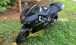 Thank you for looking at my 2012 Ducati Superbike 848 EVOS. It has been barely used. It is in showroom condition. Only 307 miles! I switched out the clear shield for a smoke shield. It has never fallen or been tipped. Absolutely perfect bike! I will