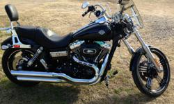 2012 dyna wide glide 103, all custom. 1400 miles, still under warranty. Over 21,000 invested. Cusom tires and wheels, custom handle bars, braided lines, stage kit, sundowner seat, smoke windshiels, taillights, and turn signals, radio,Too much