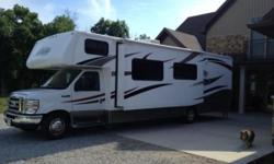 2013 Forest River Forester 3011DS Class-C Motorhome. 32?RV Ford E450 ?Low Mileage?, Features include: 4,000 watt Cummings Onan Generator, 15,000 BTU Ducted Roof Air Conditioner with Heat Pump, Factory Installed Electric Awning, Towing Package, Power