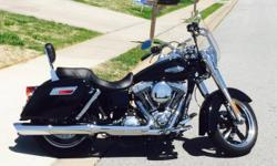 LIKE NEW - BLACK - 2013 Harley Davidson - DYNA - Switchback for sale. Purchased last year from Pig Trail in Rogers. 1K and parts install done at Pig Trail. Bike only has 1,468 miles with lots of extras. Detachable backrest, handle grips, axle nut covers,