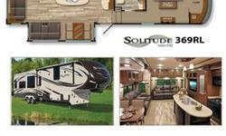 """2014 Solitude 369RL If more room is what you desire, Solitude is the most spacious Extended Stay Fifth Wheel ever built! The Solitude RV delivers taller ceilings, taller, deeper cabinets, larger scenic window areas, a full 6' 8"""" tall slide-out, and a body"""