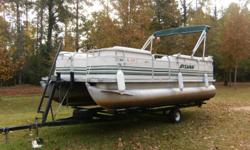 40 hp Mariner outboard motor. Needs new carpet; seats fair. Comes with 8 NEW lifejackets. Runs excellent, very good boat. Economy forces sale. -- or. --.