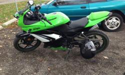 For sale ... Is a great, like new condition motorcycle: 250cc Kawasaki Ninja. Color: Green/Black Miles: 980 miles !!! Works and runs great and has no problems! All paperwork included. It's an awesome looking bike and plus I am including a nice large