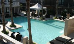 Mediterranean Style Condo for rent at the TUSCANY with wood floors, granite countertops and aluminium appliances. Own washer/dryer, private balcony, community gym, two covered parking spaces, over looks large pool with palm trees, spa, and BBQ Grills.