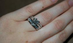14k white gold, 2ct total weight wedding set for sale! very beautiful! and taken every 6 months for cleaning. the band is 9 princess cut diamonds totaling 1ct and the engagement ring is a 1/2ct center princess cut diamond (in a cathedral setting) with 6