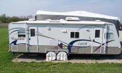 2005 Coachman Captiva Travel Trailer Length: 30 foot(total length) Dry Weight: 5140 lbs Carrying Capacity: 1190 lbs (Total GVWR: 6330 lbs) Manufactured in 2005 but first titled in 2009; sleeps six; lots of storage; stainless refrigerator and freezer;
