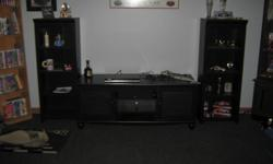 3 peices all wood a 42in flat scren well set on it nice I bought it last year at nfm for 700.00