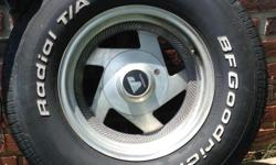 """15"""" Wheels and tires used on a GM vehicle, four 5 lug wheels, five tires withone for a spare. Both wheels and tires in good condition."""
