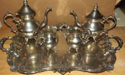 This is a 5 piece Silverplate Coffee & Tea Set made by The Baltimore Silverplate Company between 1931, and 1933. It includes the Coffee Pot, the Tea Pot, Creamer, Sugar Bowl, and Tray. Engraving patch on the tray has not been used. Will ship to the lower