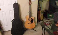 Jasmine by Takamine Acoustic /Electric Guitar w/hard case. Excellent condition.