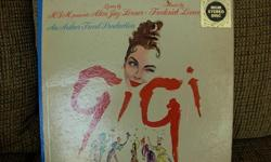 Original Cast Sound Track Album. 'GiGi' with Leslie Caron. Record Excellent condition/sleeve very good conditon. Reply by email if seriously interested.