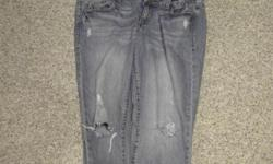 one pair of ladies AE jeans size 14R with holes paid 34.99 for them, medium blue
