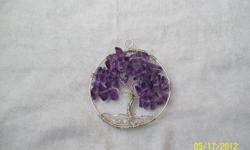This pendant is made of sterling silver at amethyst chips.Tree of life symbolize the manifestation of god.The scripture of this belief teach that the trunk and the roots of the tree are God's Spirit,while the branches and the leaves are the followers.The