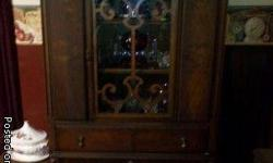 For Sale-Antique Dining Room Set. Includes Table and four chairs,buffet, and china cabinet/hutch. Must Sell! Any reasonable offer will be considered. Call () -