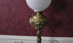 1800s  Bradley and Bradley banquet lamp for $600.  Excellent condition!  The globe is white, the base is gold platted.