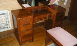 Three-piece Antique bedroom set: Chest (~ 4' tall x 3' wide x 1.2' deep); 4 poster bed - full-size; Dressing Table (~ 2.5' tall x 4' wide x 1.5' deep) Belongs in a bed bedroom. Please leave your name and phone number in the Craig's List email response and