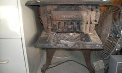 4 burner with oven wood burning cast iron stove and railroad lantern both $500.00; call for appointment 513-421-3015