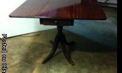 drop leaf table in excellent condition, reeded edge and reeded legs with cast brass hairy paw casters.