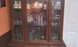 Antique wood hutch approx 6.5 ft tall has 3 glass shelves on top approx 3.5 ft long and two shelves enclosed on bottom same length seperates into two pieces for easy moving