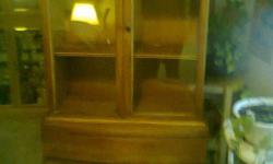FOR SALE!!!!.. An AntiQue Wooden Cabinet - Wood veneer ( I think walnut)It has 2 glass doors old Could use it as it sets or restore and have a beautiful Cabinet. Shows signs of wear, however it is complete.Deliver can be arranged. Please call --