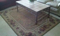 Beautiful Area Rug. 5' x 8' GREAT PRICE! Excellent condition. We do not smoke. Colors of maroon, cream, beige, hunter green. Moving and must sell! Email or call / text Nicole at 941-773-9715.