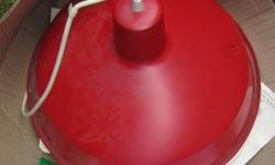 Awesome retro red pendant light with four extra circular bulbs. Has one bulb in lamp already and comes with four new circular bulbs. In good condition, has a small dent on one side as noted in photo on the right side. Measures approximately 16 inches