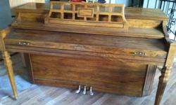 Baldwin concole piano with oak finish.  Very good condition.  Does need tuning. Please call for an appointment to see it.