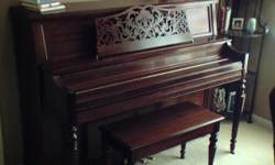 Baldwin upright piano, model 5052 Queen Anne Royal Cherry. Excellent sound, used very little, and a beautiful piece of furniture. Solid sitka spruce soundboard as well as maple hardwoods used in construction. Like new condition. Also have a few pictures I