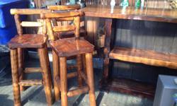 Heavy wood bar and three stools. Jackie --