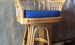 """Rattan bar stool, 37""""Hx22""""Dx25""""W, with electric blue padded seat. Maple stain. Excellent condition. Like new. Costs $250.00."""