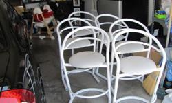 Six white bar stools, padded seat, metal frame