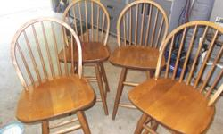 Four solid oak bar stools. Hand crafted. Good condition. Swivel chair. $20/stool.