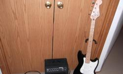 Squier Bronco Bass by Fender with bass amp. Bass guitar is new. $165.00. Nice hard case available for $65.00