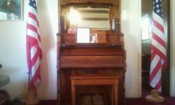Estey Pump Organ built in 1914 in Brattleboro, Vermont. It is in nearly mint condition. It is in tune and plays beautifully. It is constructed of beautifully carved walnut with a medium finish. A piano bench is included. The price will go up drastically