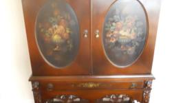 Beautiful dark wood hutch with floral inset panels in great condition. Asking $200.  Please call -- or -- and leave a message if there is no answer.