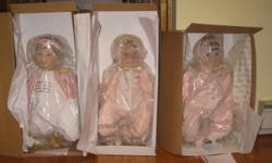 Three collectible bello dolls in box's with papers $40 each.