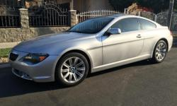 Beautiful BMW 650i for sale. Clean black leather interior with only 80k miles, has only had one owner. Very smooth runs like new, V8 engine and transmission in perfect conditions. Navigation system, Push start button, new tires, and many other upgrades.