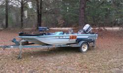 1985 tidecraft boat, 1986 70 hp evenrude motor, 1985 custom trlr, on board battery charger, in line fuel filter, tilt/trim