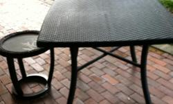 Im selling a brand new NEVER usedpatio table and matching side tabe. Beautiful dark woven wood. Side tabe has frosted glass inlay with leaf detail. LOVE this set just have no room for it since we moved.