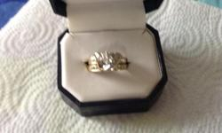 Size 8 beautiful ring set have appraisel papers appraised for 3800.00 asking 800.00