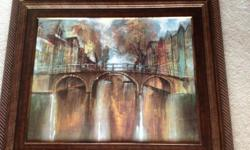 This is a beautiful picture of a bridge and town in the background. Colors are gorgeous on this picture! Blends of brown, yellow, tourquoise, orange, white and green.The wide dark wood frame compliments this picture. Size is 38