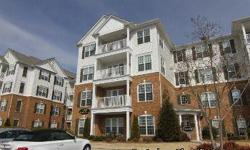 Beautiful 2 bedroom condo with office in desirable Ballantyne area! Rich hardwoods throughout. Living room is open to kitchen that is bright with white cabinets and a bar area. This is a must-see for anyone interested in being within walking distance to