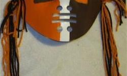 i make browns team colored masks & wall masks wall masks are 5.00 they are textured with a gloss finish hand painted and have yarn or ribbon side hangings small wall masks are 2.00 each or 3 for 5.00