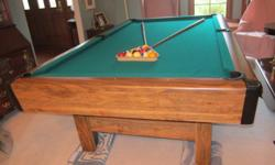 """BRUNSWICK 8' REGULATION 3/4"""" SLATE POOL TABLE Includes a new set of Belgium Balls, cues, rack, chalk, and all accessories. Has a NEW TOURNAMENT GREEN MALI 22 OZ. COVER, which is 75% wool & 25% nylon. Used very little and is in EXCELLENT CONDITION!"""