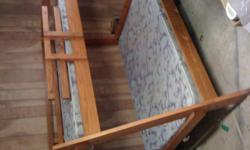 Twin size bed on top, full size on bottom.Hardly used beautiful light pine with all wood boards construction. Up graded mattresses and all still looks as good as new.Top and bottom beds face the same direction and take up less floor space.Paid $1100 ,