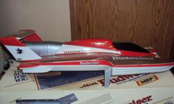 very collectable burnie little Miss Budwieser speed boat if interested call before 9 P.M. --
