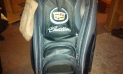 Black & Grey, Cadillac emblem.  Includes Cadillac towel and shoe bag.  Excellent shape, no longer golf or own Cadillac. Call or text, Mike --.